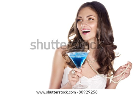 Beauty with blue cocktail at a party. Space for text. - stock photo
