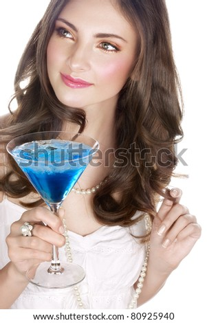 Beauty with blue cocktail on white - stock photo