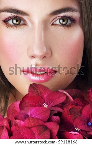 Beauty with nice makeup and purple flowers - stock photo