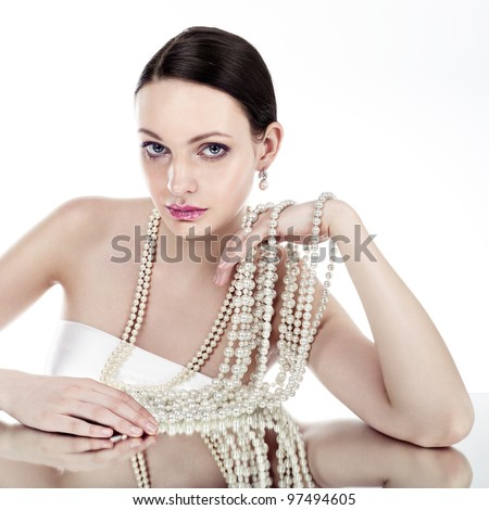 Beauty with pearl jewellery - stock photo