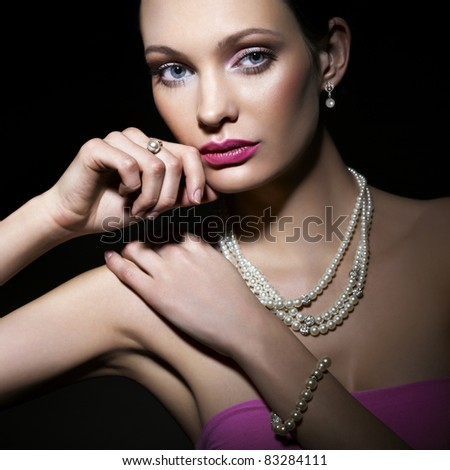 Beauty with pearl jewelry - stock photo