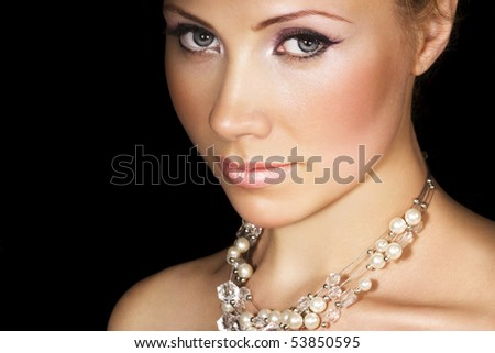 Beauty with pearl necklace on black. Space for text. - stock photo