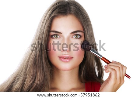 Beauty with perfect natural makeup look applying blusher - stock photo