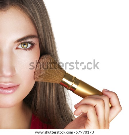 Beauty with perfect natural makeup look applying face powder. - stock photo