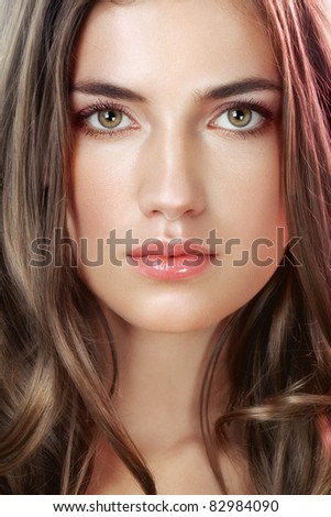 Beauty with perfect natural makeup look in pink light - stock photo