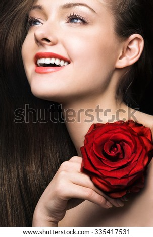 Beauty with red rose - stock photo