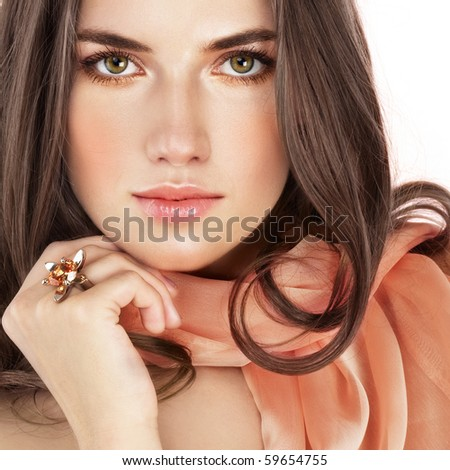 Beauty with ring and salmon color scarf - stock photo