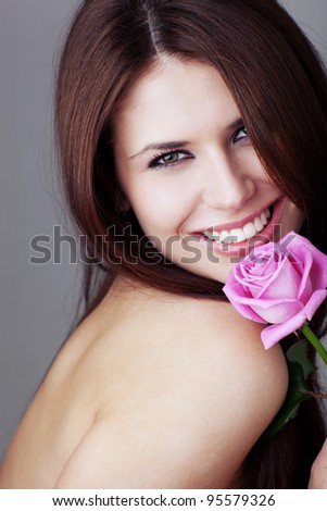 Beauty with rose. Toned