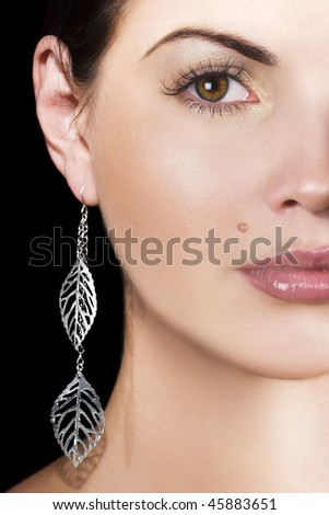 Beauty with silver earring - stock photo