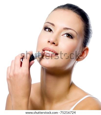 beauty woman applying lipstick on lips - isolated - stock photo