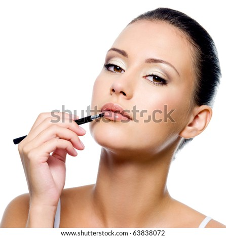 beauty woman applying lipstick on lips with brush - isolated - stock photo