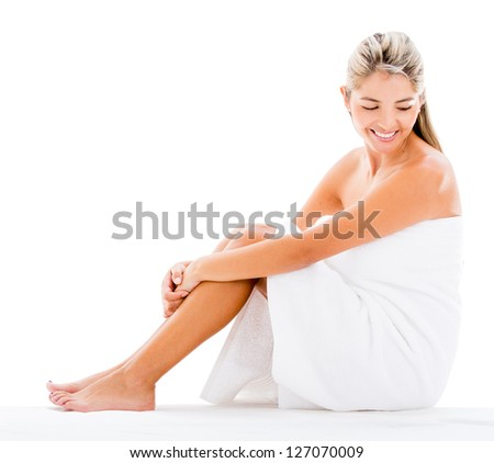 Beauty woman at the spa wrapped in a towel