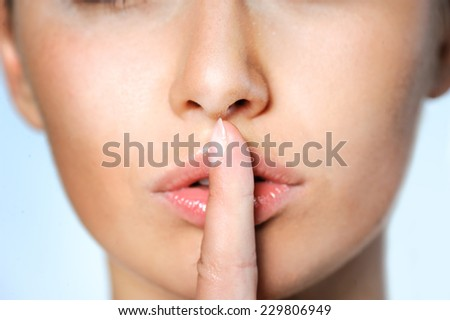 Beauty Woman. Beautiful Young Female touching Her lips. Skincare concept. Beauty Face.Perfect Skin. Healthcare concept.Beauty concept. - stock photo