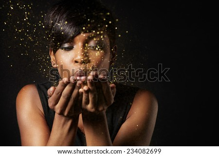 beauty woman blowing a stardust. Make a wish concept - stock photo