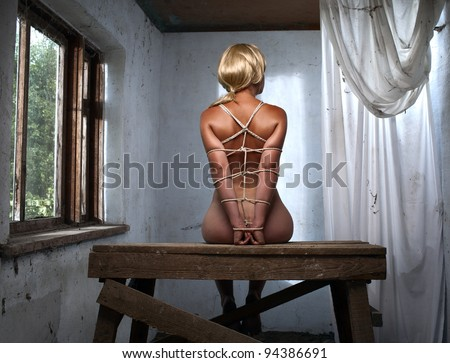 beauty woman bondage on the table - stock photo