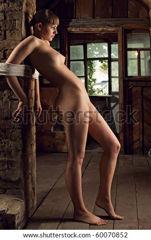 beauty woman bound in old room - stock photo