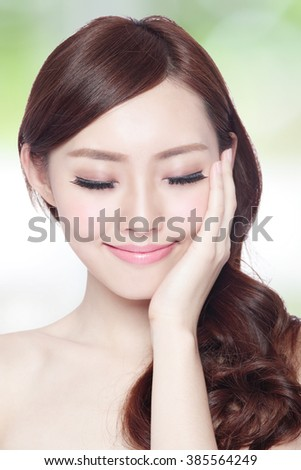 Beauty woman charming smile and relax closed eye enjoy with health skin and hair isolated on green background, asian beauty - stock photo