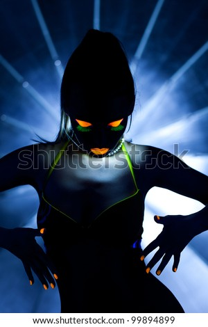 Beauty woman dance with glow make-up - stock photo