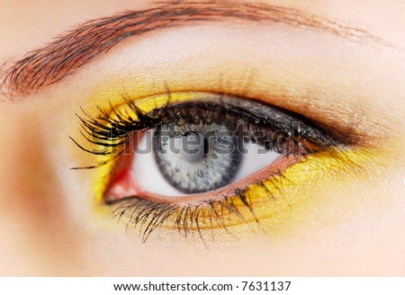 Beauty. Woman eye with yellow eyeshadow. - stock photo