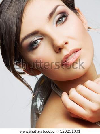 Beauty woman face close up. Female model studio posing. - stock photo