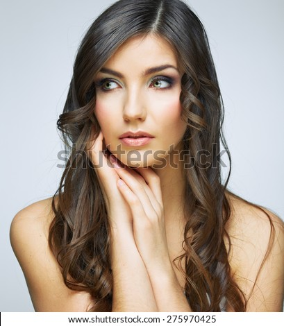 Beauty woman face close up portrait. Girl with long hair looking up side. Female model studio portrait.