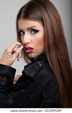 Beauty woman face closeup isolated on background. Beautiful model girl makeup. Gorgeous sexy brunette lady with perfect make up - stock photo