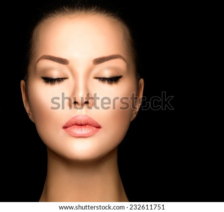 Beauty woman face closeup isolated on black background. Beautiful model girl makeup.  Gorgeous lady with closed eyes. perfect skin