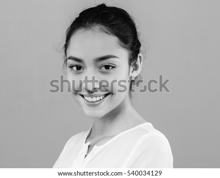 Beauty Woman face Portrait. Beautiful model Girl with Perfect Fresh Clean Skin color lips purple red. Healthy teeth smile Youth and Skin Care Concept. Black and White.