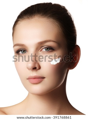 Beauty Woman face portrait. Beautiful spa model girl with perfect fresh clean skin. Female looking at camera and smiling. Youth and skin care concept. Over white background - stock photo