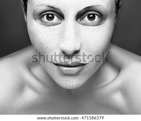 Beauty Woman face Portrait. Beautiful Spa model. Mask of clay on her face. Fresh Clean Skin.