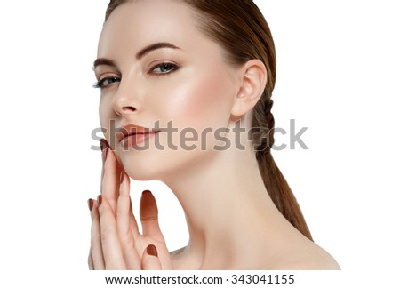 Beauty Woman face Portrait Girl with Perfect Fresh Clean Skin female looking at camera smiling.Youth and Skin Care Concept.Cheerful girl is touching her cheeks pleasure.Isolated on white - stock photo