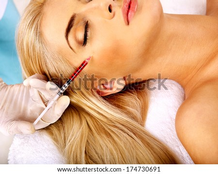 Beauty woman giving facial injections. - stock photo