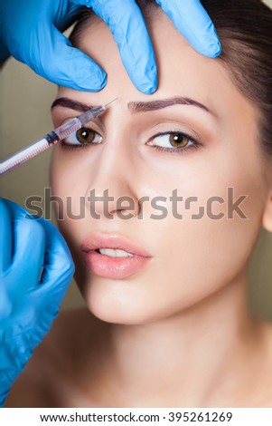 Beauty woman giving medical injections. Cosmetology. Beauty Face - stock photo