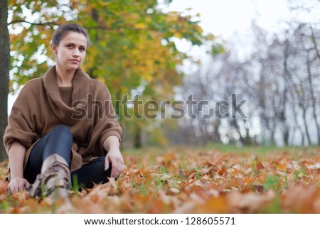 beauty woman  high shoes at autumn park - stock photo