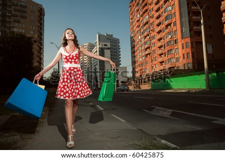 beauty woman in city with color bags