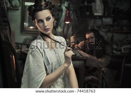 Beauty woman in old  atelier - stock photo