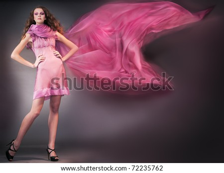 beauty woman in pink dress shooting mix light - stock photo