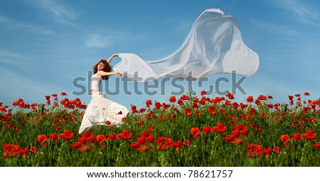 beauty woman in poppy field with white tissue under sky - stock photo