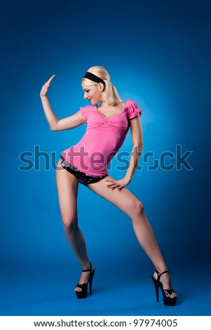 Beauty woman in rose dance on blue background