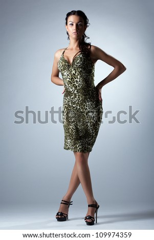 Beauty woman in sexy dress studio portrait - stock photo