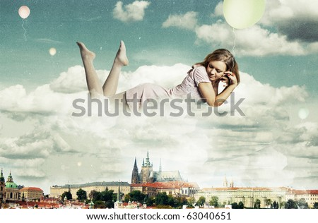 beauty woman in the clouds over Prague - stock photo