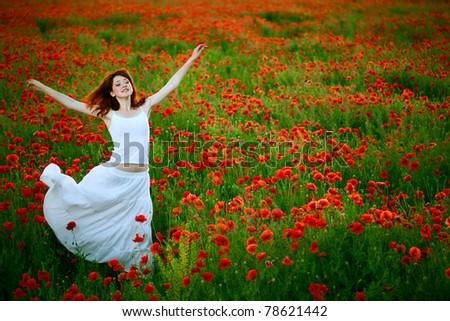 beauty woman in white dress running poppy field - stock photo