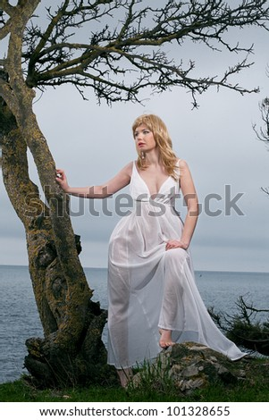 beauty woman in white dress with tree - stock photo