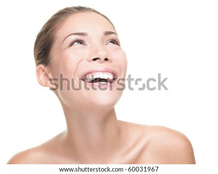 Beauty woman laughing / smiling looking at copy space. Face beauty portrait of happy young asian / caucasian model isolated on white background,