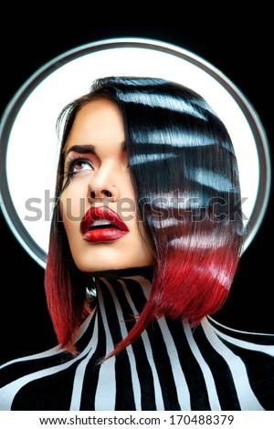 beauty woman looks like Rihanna on black background in studio - stock photo