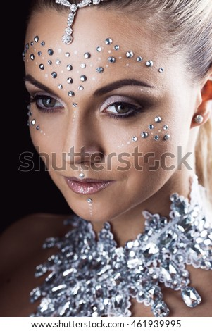 Beauty woman makeup with crystals on face, black background