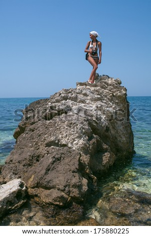 beauty woman on sea under blue sky