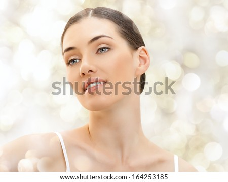 beauty woman on the blur background - stock photo