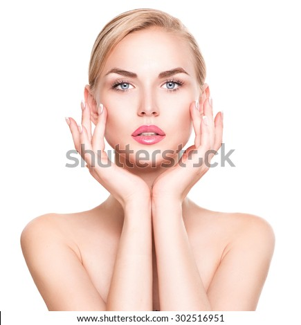 Beauty Woman Portrait. Beautiful Spa Girl Touching her Face. Perfect Fresh Skin. Pure Beauty Model Female looking at camera. Youth and Skin Care Concept. Isolated on white background  - stock photo