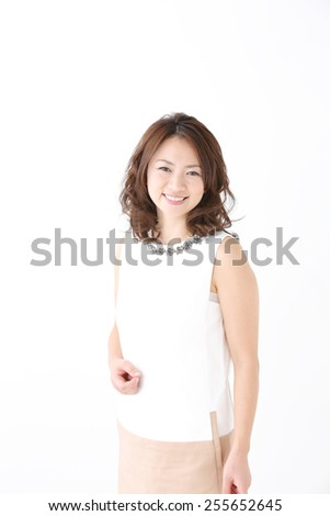 Beauty Woman Portrait. Healthy Long Curly Hair. Beautiful Young Woman isolated on a white background - stock photo